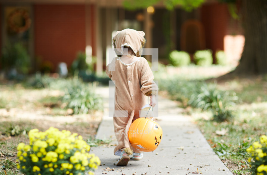 a child trick-or-treating