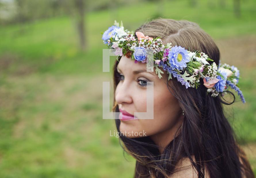 woman wearing crown of flowers