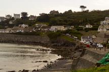 sea wall along the shore of a coastal town