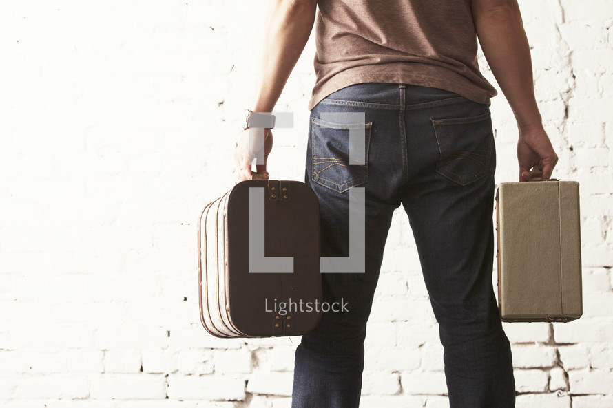 man carrying suitcases