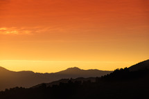 orange and yellow sky and mountains