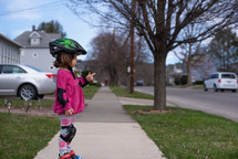a toddler girl roller skating