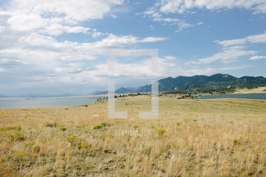 riverbanks, river, mountains, water, sky, outdoors, tall grasses