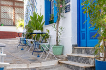 outdoor seating by a blue door