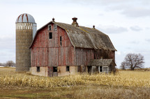 an old barn and silo