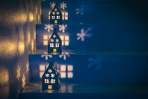 house shaped luminaries on steps at Christmas