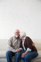 a happy, loving elderly couple