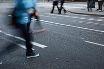 people walking across a crosswalk.