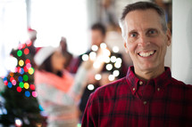 A man smiling at a Christmas party