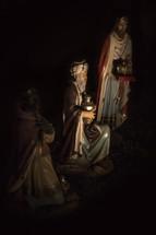 Three wisemen in nativity scene.