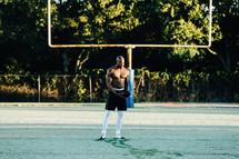 a man on a wet football field