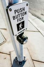 Crosswalk sign button on pole cross street city