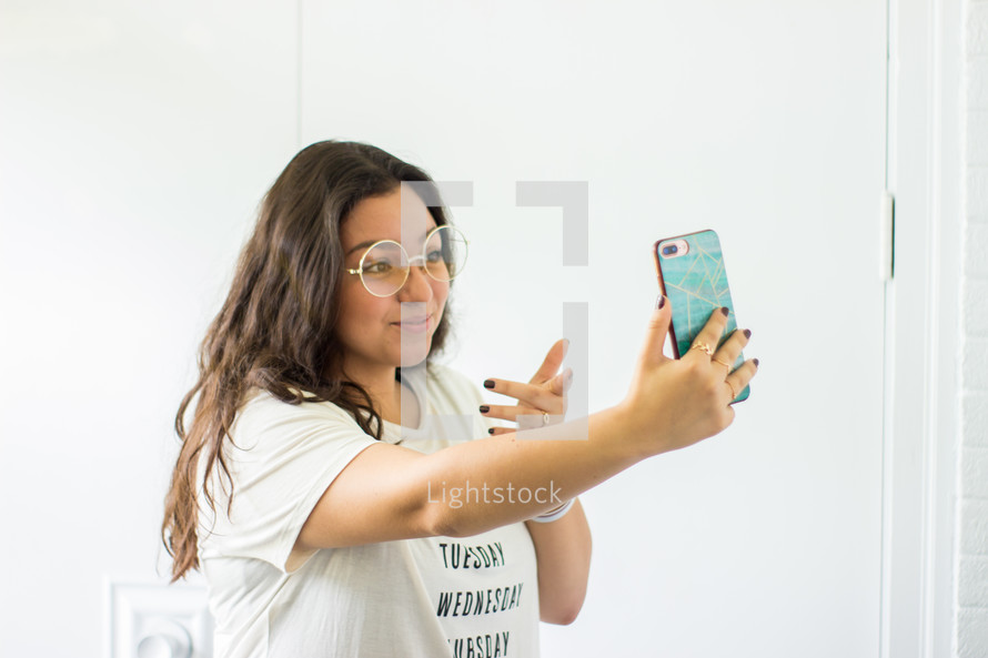 a young woman taking a selfie