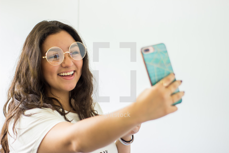 a teen girl taking a selfie