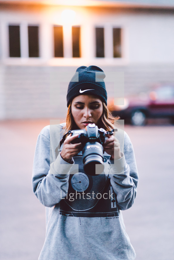 a photographer looking at her camera