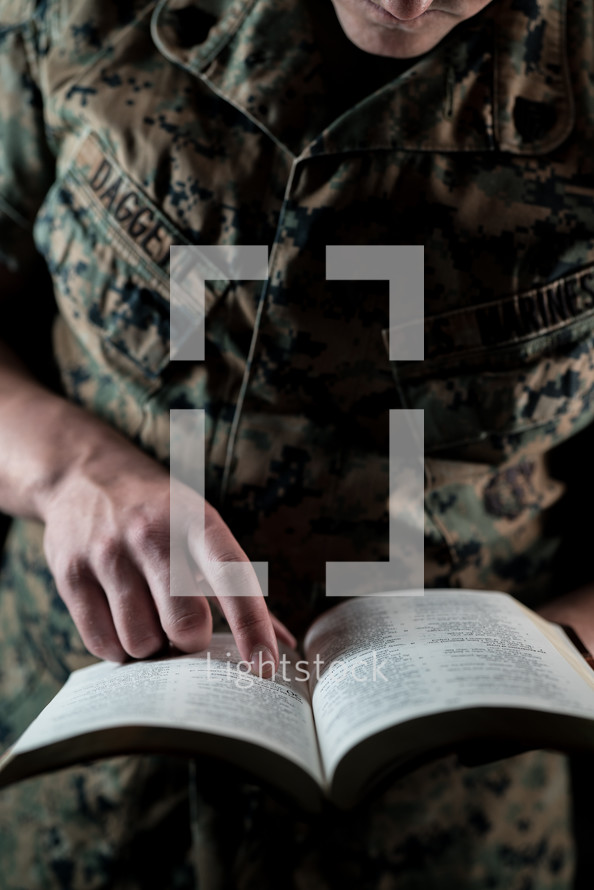 marine reading a Bible