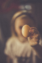 young girl holding an Easter egg