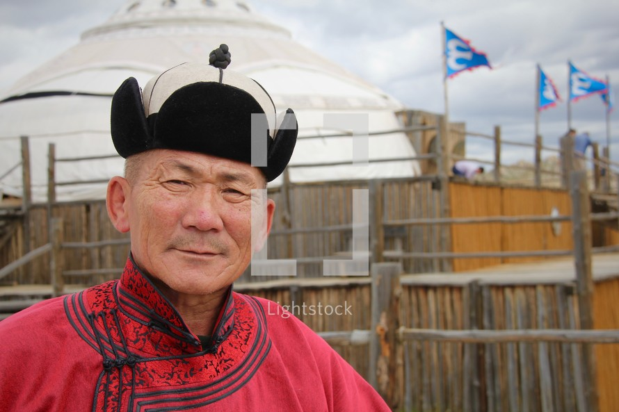 Headshot of a Mongolian man in traditional dress