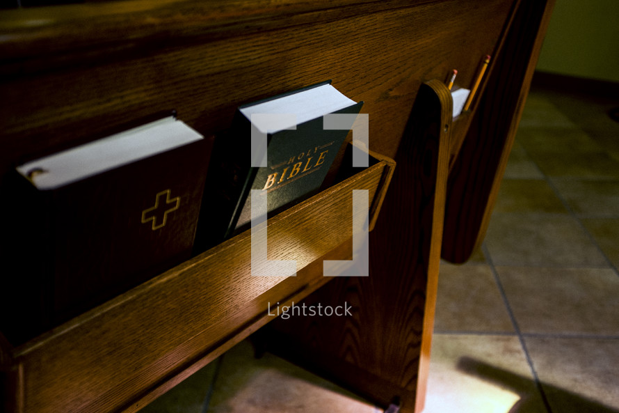 Bible and hymnals in the back of church pews