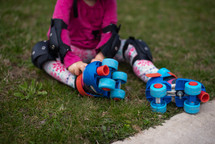 child putting on roller skates