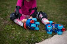 child putting on roller skates