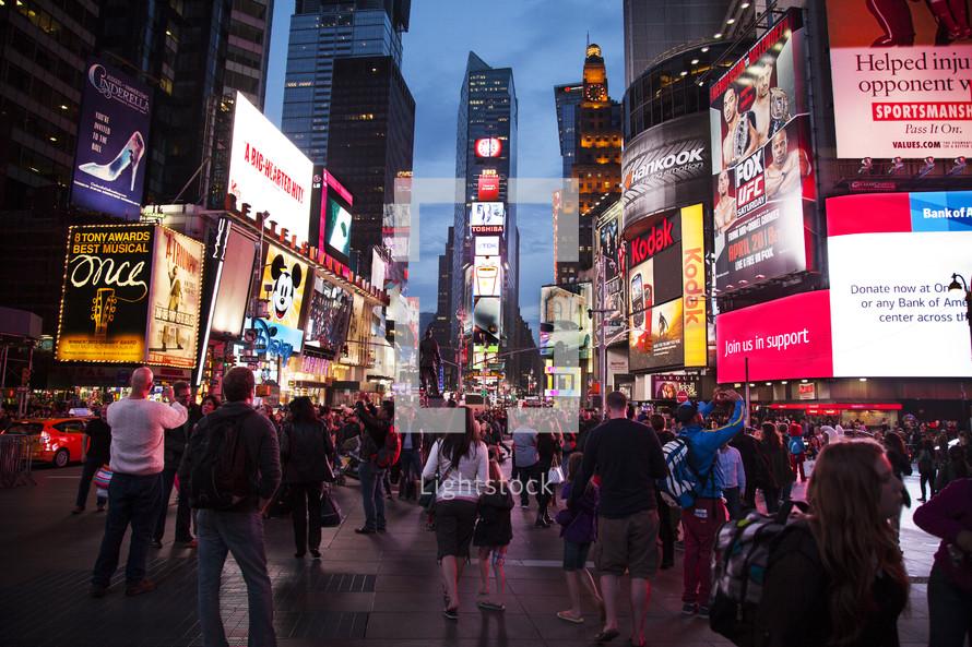 New York City pedestrians at night.