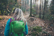 woman backpacking on a nature trail