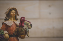 pilgrim and turkey figurine