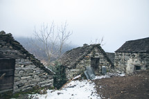 stone cabins on a mountaintop