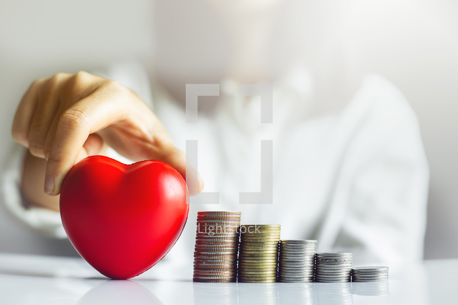 heart and stacks of coins