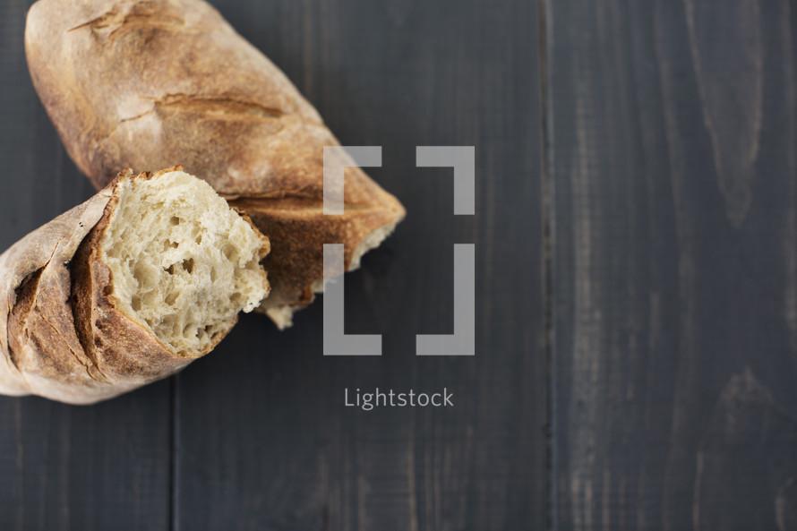bread loaf torn into halves.