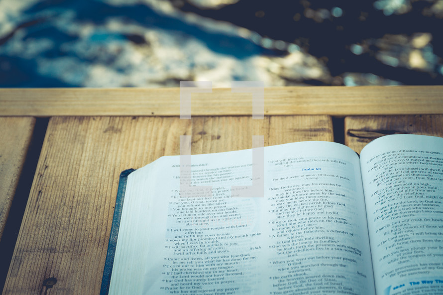 opened Bible on a dock