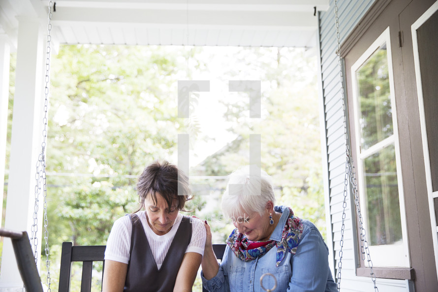 women praying together at a woman's group Bible study