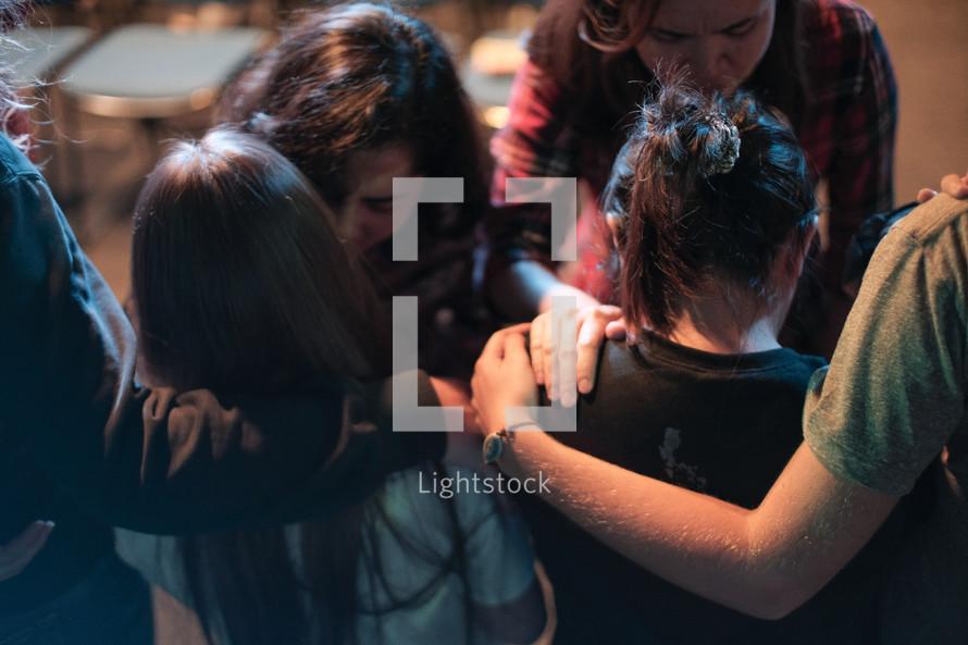 lying on of hands in prayer