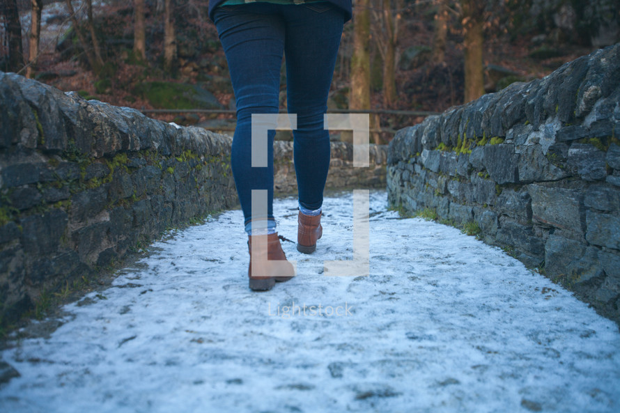 a woman hiking on a path