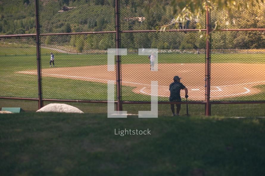 man at bat at a baseball diamond