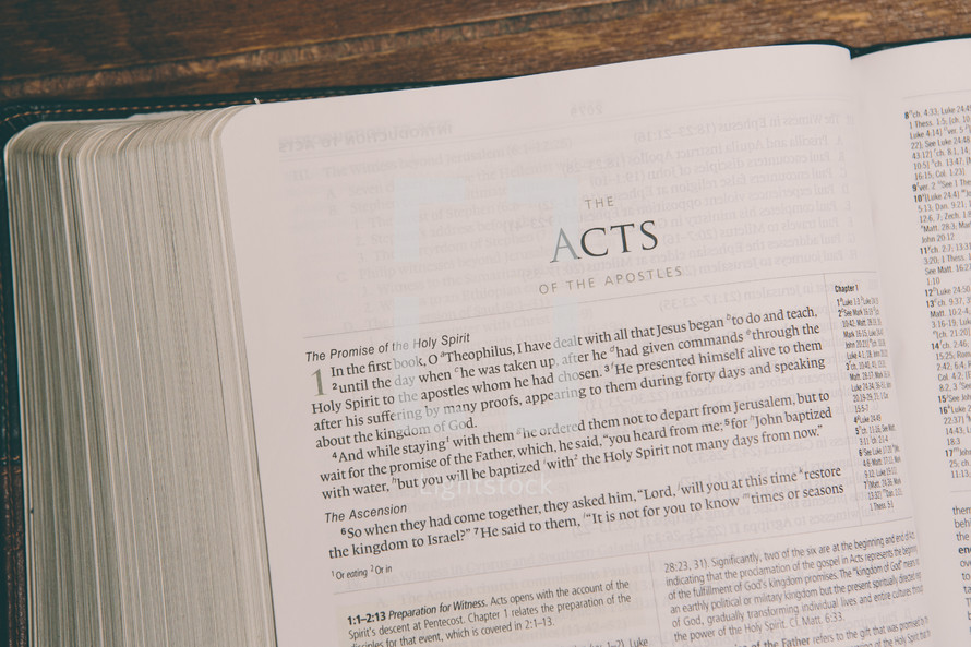 Bible opened to Acts