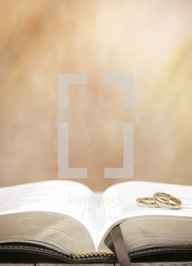 Wedding Bands on an Open Bible