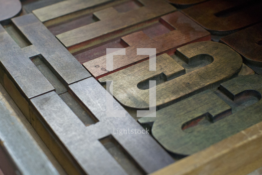 letters on a metal press
