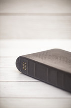 Holy Bible on a white wood background