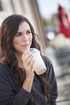 woman drinking a milkshake