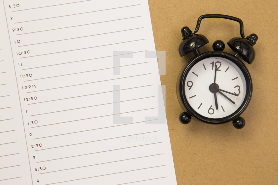 alarm clock and planner page
