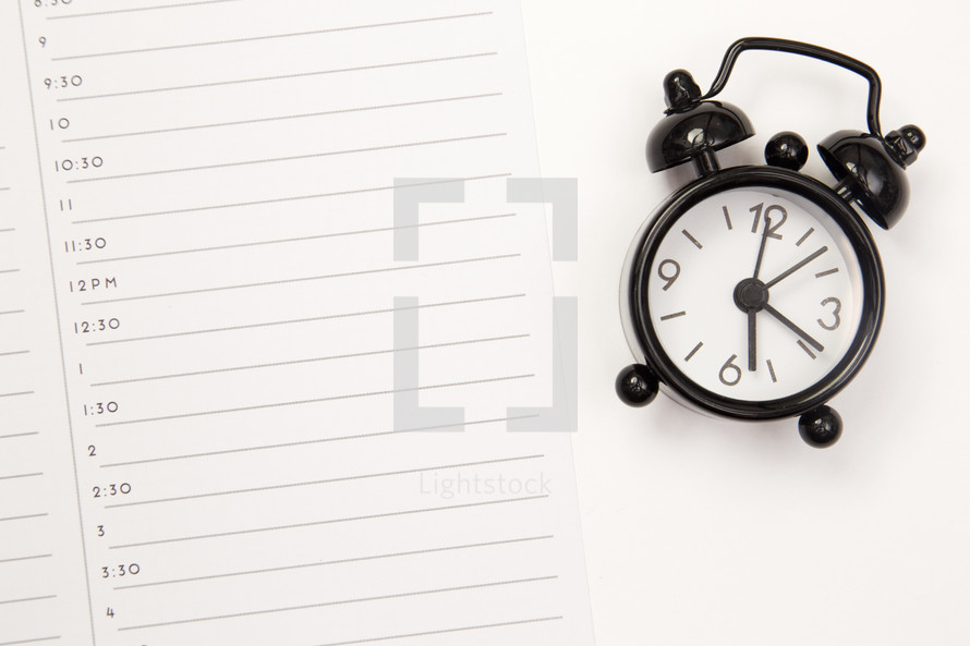 alarm clock on a planner page
