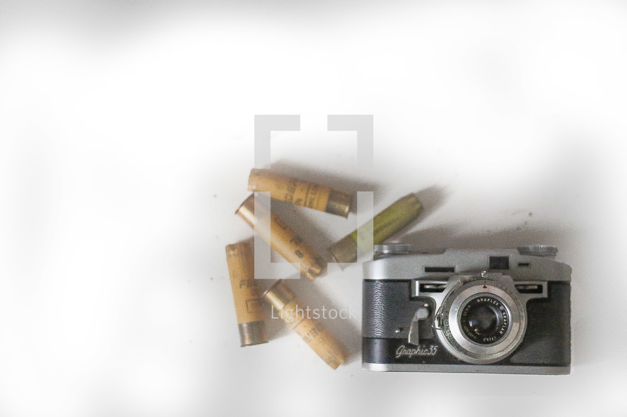 old shell casings and vintage camera