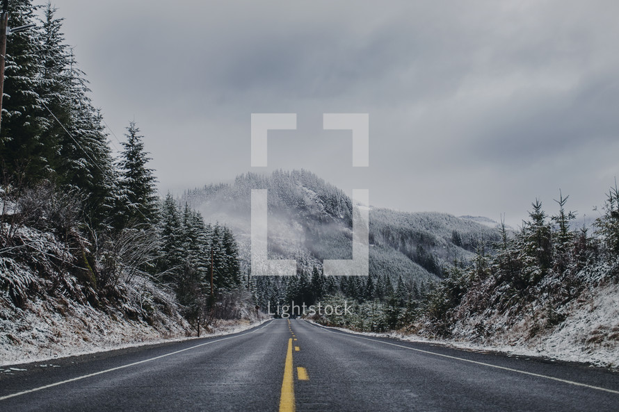 a dusting of snow and mountain highway