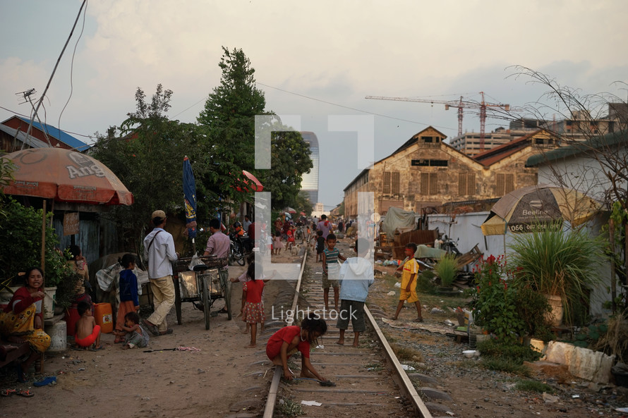 children playing on train tracks