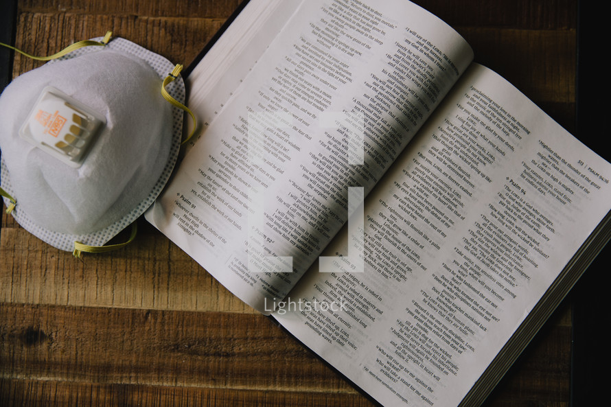 pages of a Bible and mask