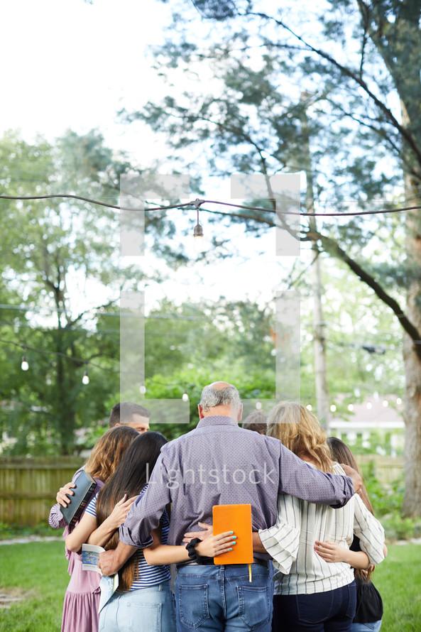 BIble study group praying outdoors