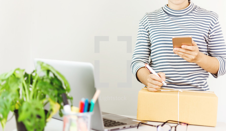 a woman shipping a package - working from home