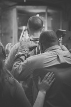 fellowship and prayer at a worship service